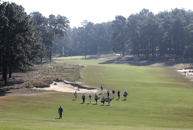 Players walk the 4th hole during a practice round. (USATSI)