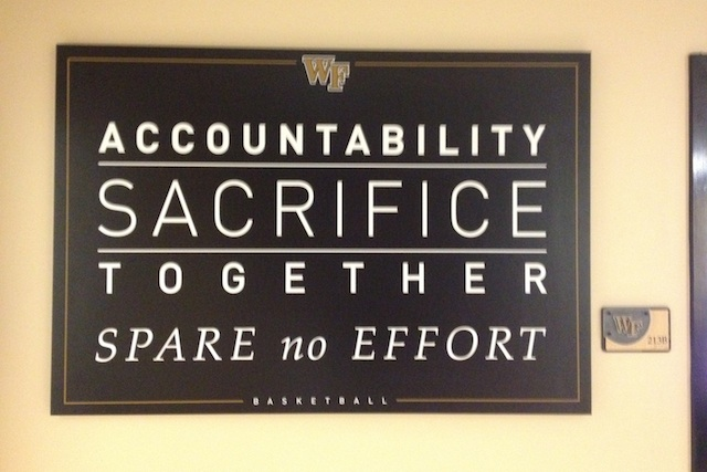 Manning's coaching philosophy welcomes each visitor to the basketball offices. (CBSSports.com)