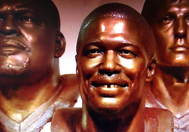 Michael Strahan's bust features his smile and a gap in his teeth.