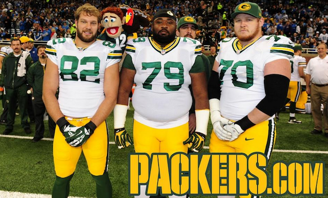 Aaron Rodgers incorporated a prop into his Thanksgiving photobomb. (Packers.com)