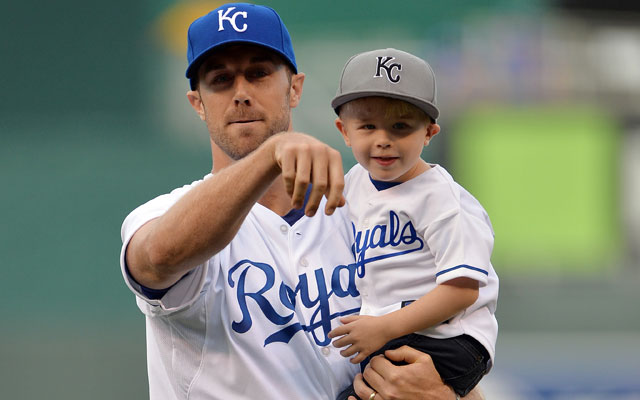 Alex Smith and his son threw out the first pitch at the Royals game Friday.