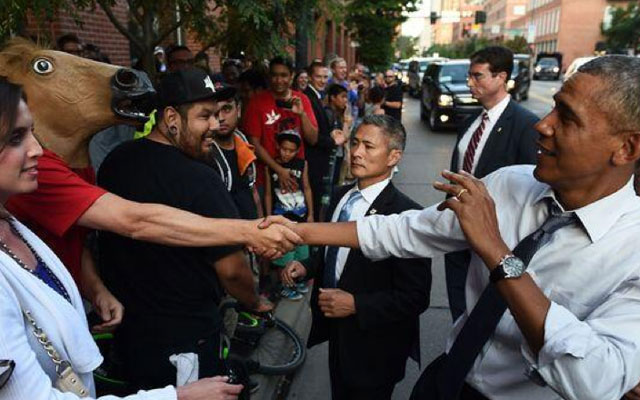 Barack Obama met a man in a horse head in Denver recently.