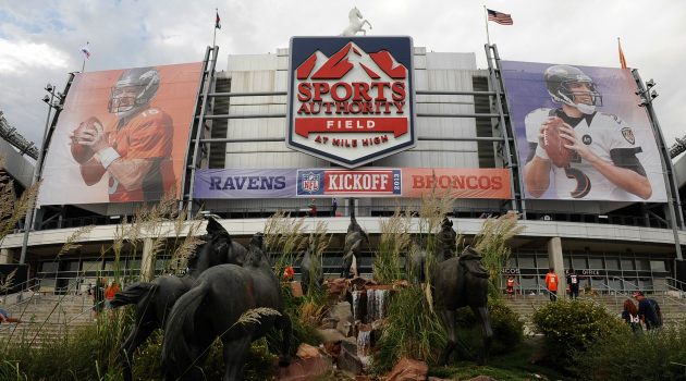 A Broncos fan fell off an escalator at Sports Authority Field on Thursday.