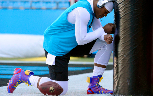 42c0fa755668 Cam Newton is sporting some colorful Superman cleats in warmups on Sunday.