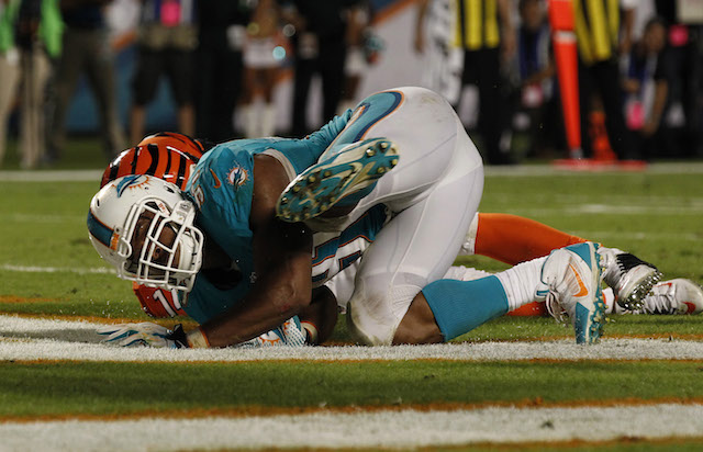 Thursday's game ended with Cameron Wake lying next to Andy Dalton in the end zone. (USATSI)