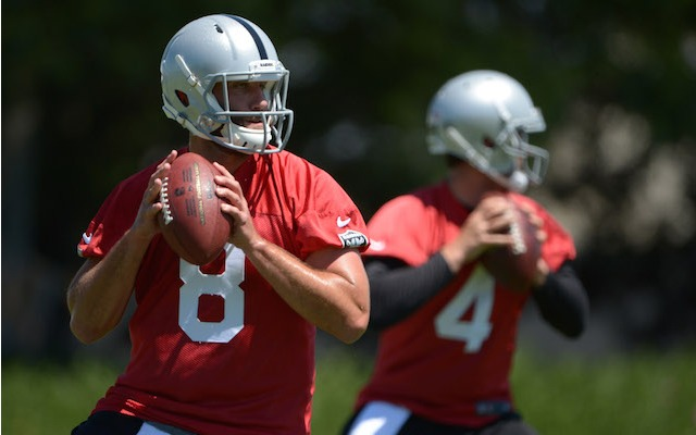 One of these guys will be the starting quarterback in Oakland this season. (USATSI)