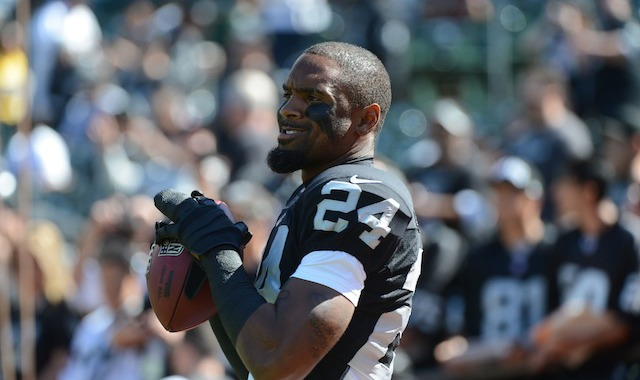 Charles Woodson tied an NFL record with his 13th defensive touchdown. (USATSI)