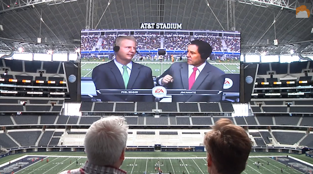 This is what video game versions of Phil Simms and Jim Nantz look like on a giant screen. (TeamCoco/YouTube)