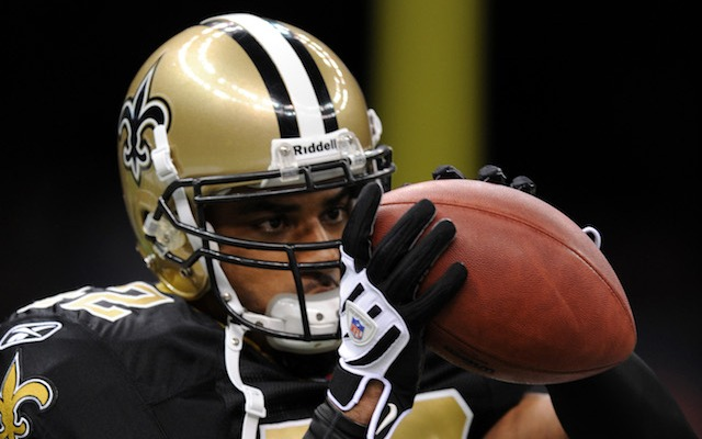 Darren Sharper held without bail after surrendering to police