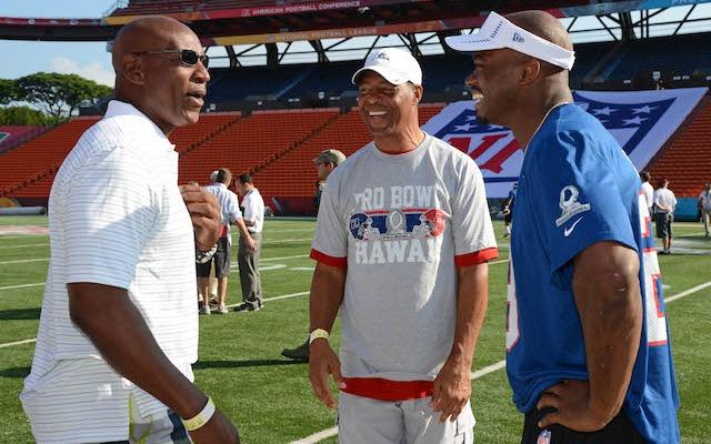 Eric Dickerson [left] thinks Adrian Peterson [right] needs some quarterback help. (USATSI)