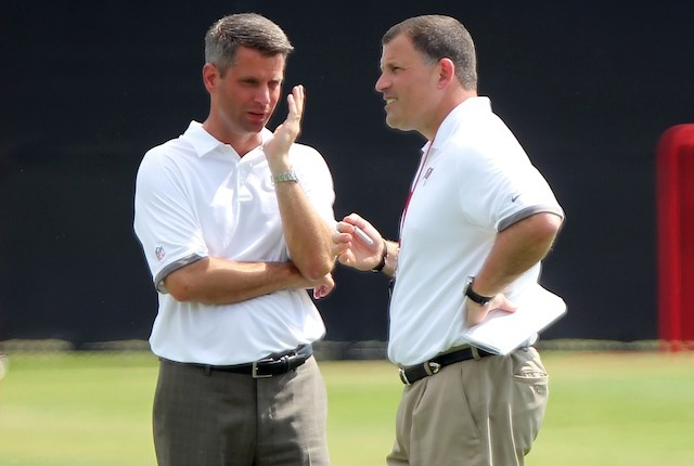 Mark Dominik [left] and Greg Schiano during less stressful times. (USATSI)