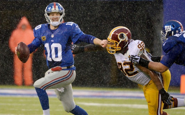 Eli Manning didn't play a snap in the second half after spraining his ankle. (USATSI)