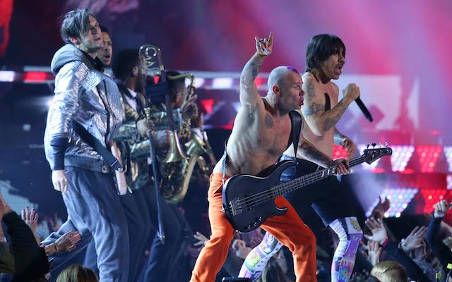Hey Flea, your guitar isn't plugged in. (USATSI)