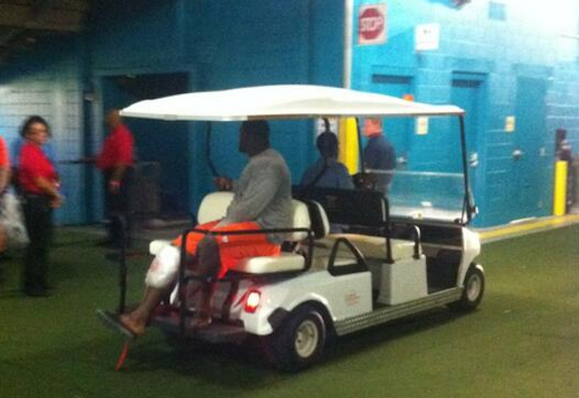 Geno Atkins spent halftime sitting on a golf cart with ice on his knee. (Twitter)