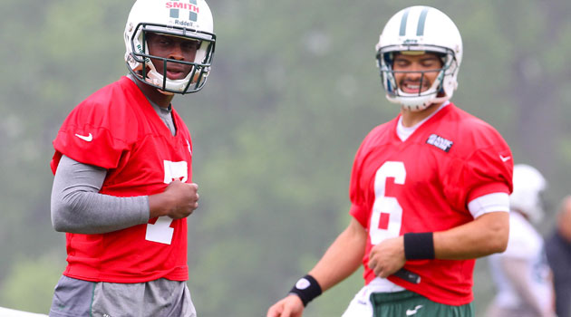 Mark Sanchez and Geno Smith are just having a real good time. (USATSI)