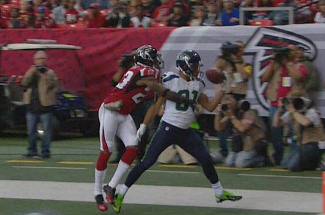 Golden Tate flexes as he hauls in a one-handed touchdown pass against the Falcons. (Fox)