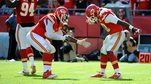 Tamba Hali [left] is taking Justin Houston's spot on the projection list. (USATSI)