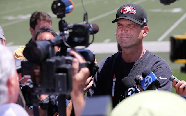 Jim Harbaugh and the 49ers are putting contract talks on hold. (USATSI)