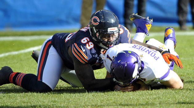 Henry Melton will play under his franchise tender for the Bears in 2013. (USATSI)