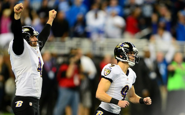 Justin Tucker [right] anxiously watches his 61-yard field goal. (USATSI)