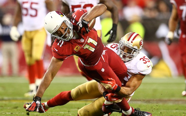 Thanks to Larry Fitzgerald, the Cardinals will have some extra cap space in 2014. (USATSI)