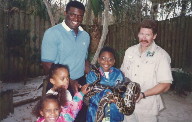 Lawrence Taylor and children with a giant snake.
