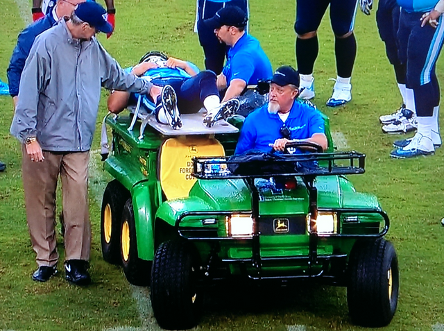Titans quarterback Jake Locker was carted off the field in the third quarter on Sunday. (CBS)