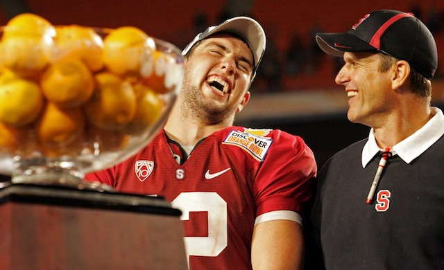 Jim Harbaugh and Andrew Luck once ate oranges together. (USATSI)