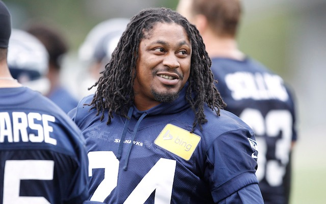 Marshawn Lynch is actually going to show up for training camp. (USATSI)