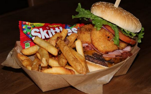 'The Beast' burger has everything on it, with a side of Skittles.