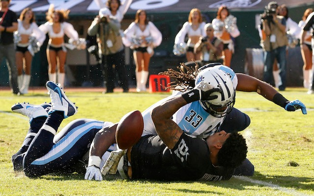 Michael Griffin's hit knocked the helmet off of Oakland's Mychal Rivera. (USATSI)