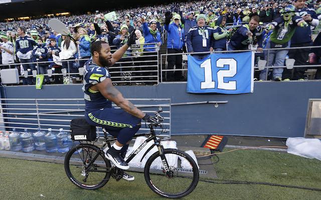 https://sports.cbsimg.net/images/blogs/Michael_Bennett_Bike_Charity_Auction_Seahawks_Packers.jpg