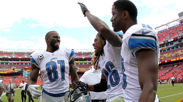 Nate Burleson (right) suffered a broken arm early Tuesday morning.