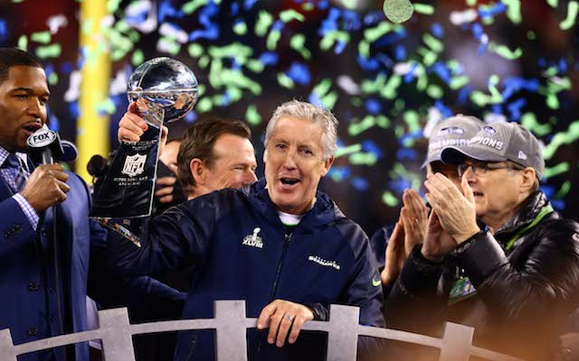 Seahawks owner Paul Allen [right] rewarded Pete Carroll for winning a Lombardi Trophy. (USATSI)