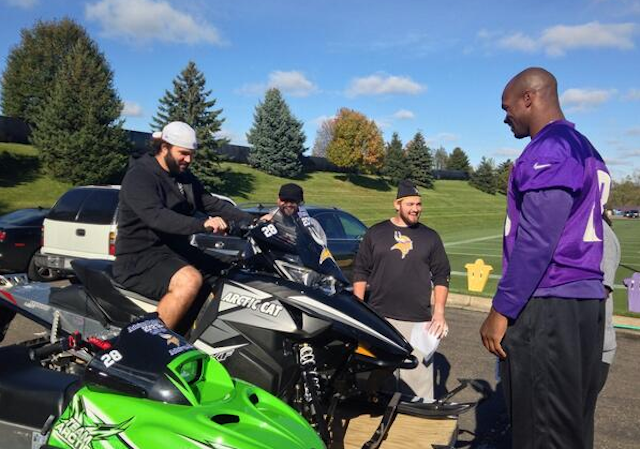Adrian Peterson handed out snowmobiles to his offensive line. (Twitter)
