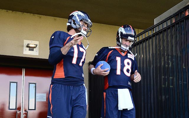 Peyton Manning shows off his blue ball at training camp. (USATSI)