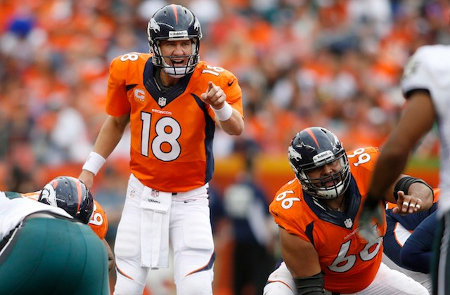 Is Peyton Manning pointing at the person who was shouting 'Papa John's?' (USATSI)