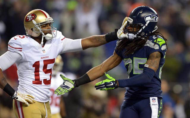 This is how Michael Crabtree reacted to Richard Sherman's taunting. (USATSI)