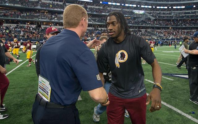 Is RG3 talking to his future coach? (USATSI)