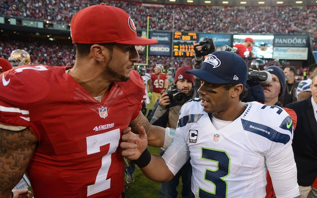 Russell Wilson and Colin Kaepernick are on the cover of Sports Illustrated. (USATSI)