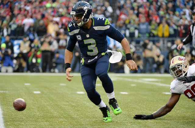 Aldon Smith stripped Seahawks quarterback Russell Wilson on the first play from scrimmage. (USATSI)