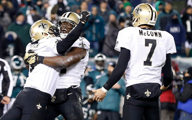 Somehow, Luke McCown got left out of the celebration after Shayne Graham's game-winner. (USATSI)