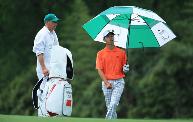 Tianlang Guan was penalized one stroke for slow play at the 2013 Masters. (Getty Images)