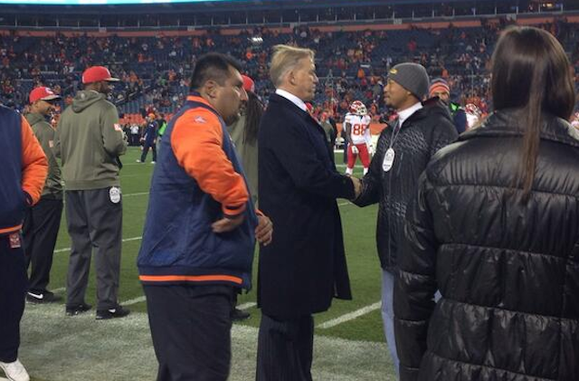 Tiger Woods and John Elway are doing their secret Stanford handshake. (Twitter)