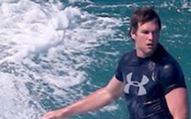 Tom Brady knows how to ride a wave. (imagedirect.com via TMZ)