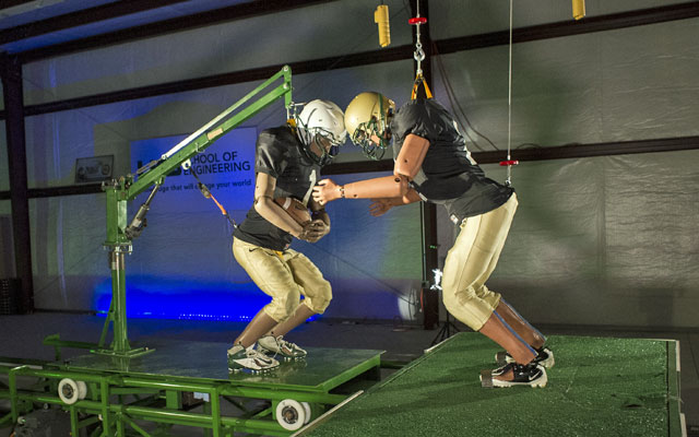 Dr. Dean Sicking has begun using crash-test dummies on a sled to better replicate impact from on-field collisions. (UAB)
