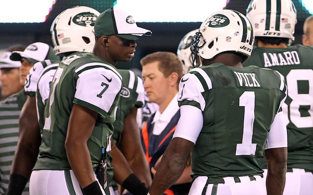 Michael Vick [right] has some advice for Geno Smith, 'Win now.' (USATSI)