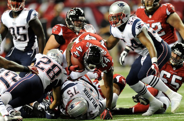 Vince Wilfork [bottom of the pile] suffered a torn Achilles on the Falcons first possession. (USATSI)