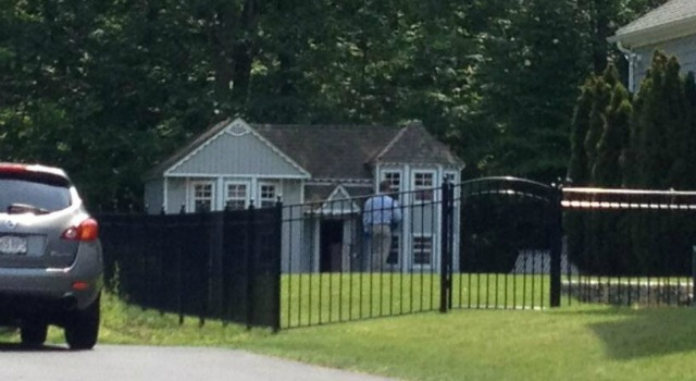Police search near what is either a dollhouse or a doghouse on Aaron Hernandez's property. (@KevinGArmstrong)