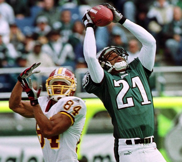 Philadelphia's Bobby Taylor makes the leaping interception over Washington's Andre Reed. (Getty Images)